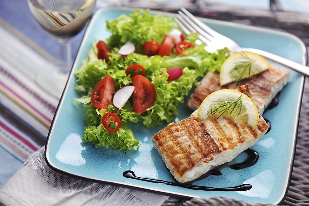 Grilled Salmon Steak With Fresh Salad And Balsamic Vinegar Sauce