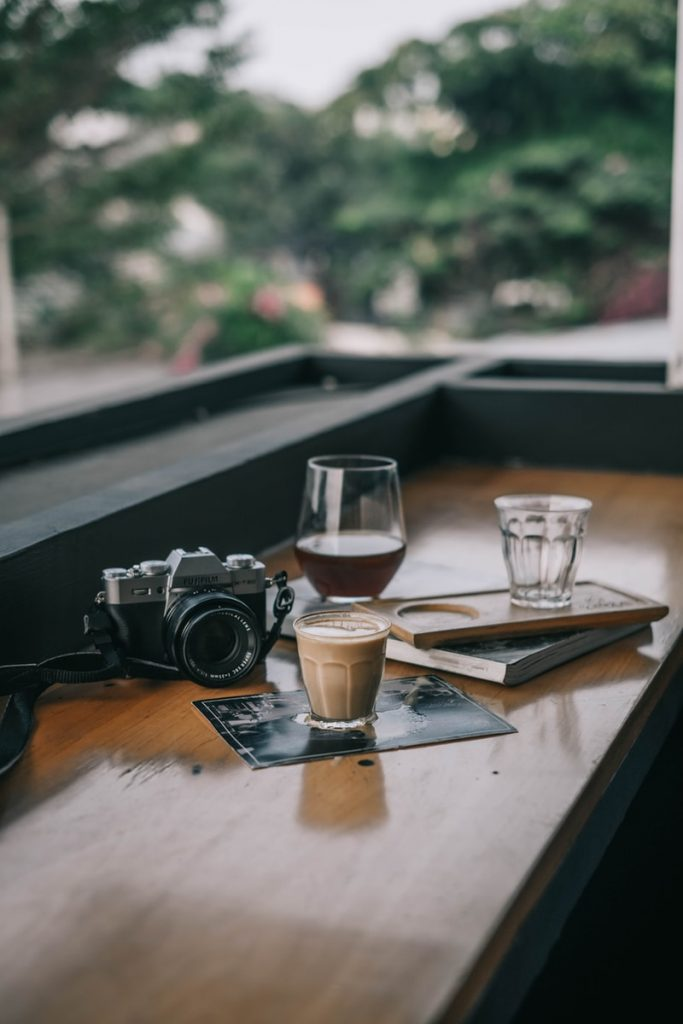 black camera on brown table